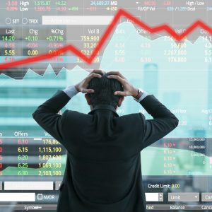 businessman upset, stock market crash