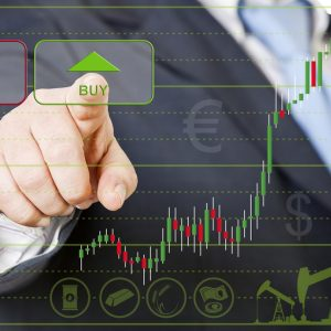A closeup of a stock trader hitting a green arrow on a stock chart